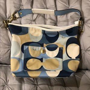 "Coach bag. Blue, cream, and tan ""C's""."